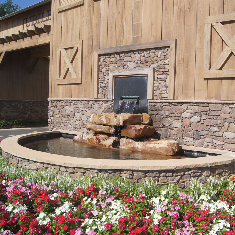 Fountain with Rocks by Barn